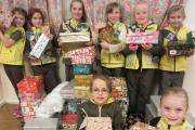Brownies collect gifts for homeless charity